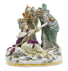 A Meissen porcelain figural group: The Peace late 19th century A Meissen porcelain figural group: The Peace late 19th century After the model by C.G. Juechtzer, modeled as a fallen queen, a maiden holding a cornucopia pausing to assist her, an altar to the reverse, underglaze blue crossed swords,