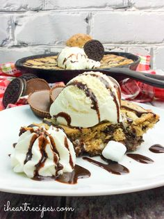 A huge deep dish cookie with layers of ooey going chocolate chip cookie dough, Oreo Cookies, and Reese's Peanut Butter Cups! My sweet tooth has been notorious lately. What better to to satisfy my hunger with a dessert that has ALL of my favorites in one dish? This amazing deep dish Oreo & Reese's Skillet cookie has it all. Layers of chocolate chip cookie dough, with Reese's Cups, and Oreos!! But wait! There's more. This dessert also has marshmallows, and graham cracker cru...