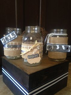 Mason jars for centerpiece a with burlap, ribbon and a few sticker accents.