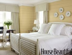 "The ""clapboard"" walls give a coastal feel to this bedroom, I do not care for the paint color."