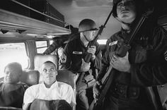 1961 | Freedom Riders Julia Aaron and David Dennis sit aboard an interstate bus as they and 25 other civil rights activists are escorted by Mississippi National Guardsmen on a violence-marred trip between Montgomery, Alabama, and Jackson, Mississippi. Originally published in the June 2, 1961, issue of LIFE.