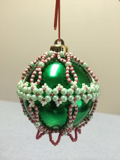 Using pearls and size 11 seed beads Beaded Ornament Covers, Beaded Ornaments, Handmade Ornaments, Handmade Christmas, Crochet Christmas Ornaments, Christmas Baubles, Holiday Ornaments, Christmas Decorations, Christmas Projects