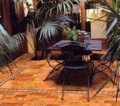 Sunroom with tile floor.