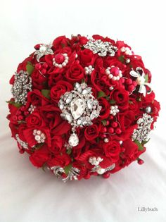 I like this for a winter wedding...love the bling! The Victoria Red Rose Artificial Bouquet and Clutch Purse