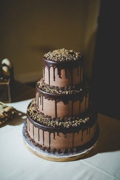For a less conventional wedding cake, consider chocolate. Although it's a beloved flavor, chocolate frostings and fondants are often overlooked for paler, pastel colors. Give our gallery a look for some delicious inspiration. Chocolate Drip Cake, Chocolate Frosting, Hot Chocolate, Chocolate Wedding Cakes, Chocolate Grooms Cake, Chocolate Cake Designs, Chocolate Covered, Drip Cakes, Beautiful Cakes