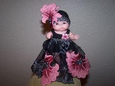 # 707 Black/grey/pink lace dress with matching fancy hat.