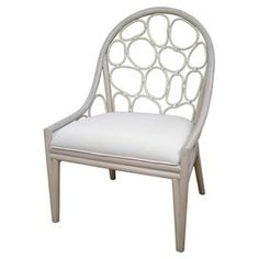 "$254  Hand-woven rattan side chair with abstract open back detail and a whitewash finish.   Dimensions: 40"" H x 26"" W x 25"" D"