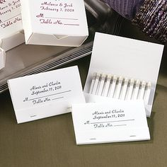 These white place cards are actually matchbooks that double as the perfect wedding favor. Price includes printing your names, wedding date and a place card verse in the foil color of your choice.