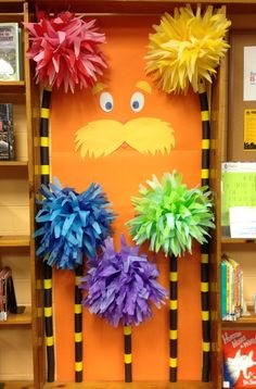 The Lorax is peeking out behind truffula trees in the Children's Area of the Mt. Healthy branch. I wonder if Dr. Seuss books can be found nearby?