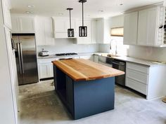 """Take a look at this contrast of a Scottsdale remodel we completed 2 years ago. With 42"""" upper cabinets with crown moulding to a contrasting color island.   American Construction & Renovation 480-404-3033 AmericanConstructed.com #AmericanConstructed @AmericanConstructed"""