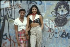 Two girls posing in front of a graffiti wall in Lynch Park, Brooklyn. | 32 Revealing Photos Of New York City In The 1970s