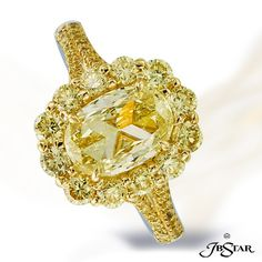 Natural fancy yellow diamond ring featuring a magnificent 1.50 ct oval FY diamond surrounded by 12 round fancy yellow diamonds and accented by fancy yellow micro pave. 18KY