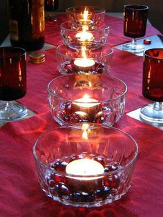 tealight_centerpieces......beads inside the votive holders match the glasses and tablecloth.  So ingenuous and pretty........