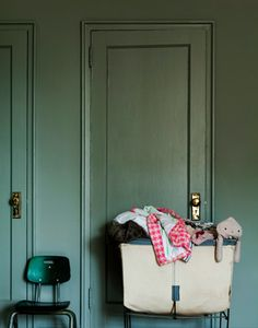 Interior Color. basket of blankets in front of a textured wall with minimal props