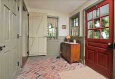 Mudroom Design Ideas. This mudroom has plenty of storage and caracther. I love the brick flooring and the paint color in this space. #Mudroom #MudroomDesign #MudroomIdeas