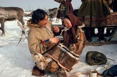 Nenets man plays with his daughter at a meal break. Yamal. Siberia. Russia.: Russia, Yamal: Arctic & Antarctic photographs, pictures & images from Bryan & Cherry Alexander Photography.