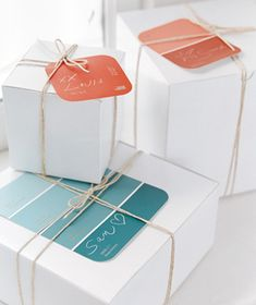 Paint chip gift tags. It would be a fun project to have the kids stamp some of these for us to use at Christmas. -khh