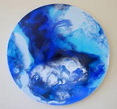 Hand painted abstract resin artwork on canvas. 50cm round.