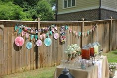 Photos and flags on the hence! With mason jars for tea and lemonade! The classic decor for a southern lawn grad party!