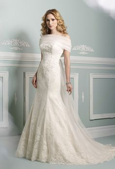 Brides: James Clifford Collection. Traditional, lace and tulle applique, strapless, A-line wedding dress, and floor length hemline.