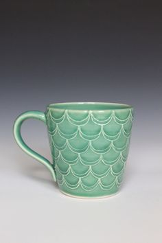 Porcelain Ceramic Mug with Slip Trailed Pattern in Green Glaze, Wheel Thrown OOAK. $28.00, via Etsy.