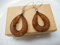 2100,- Baltic Amber and Mesh Tube Earrings Contemporary and elegant, Earrings is made of a lightweight polyester mesh tube with resin amber flowing loosely