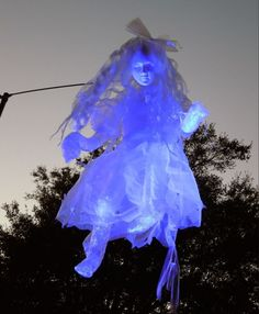 ghost girl. foam head. packing tape limbs. white trash bag dress. by penny