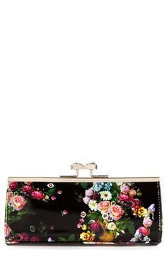 Free shipping and returns on Ted Baker London Floral Print Crystal Bow Clutch at Nordstrom.com. Vintage posies bloom on the black patent backdrop of a charming Ted Baker London clutch topped with a crystal-encrusted clasp.