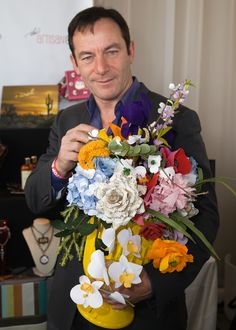 "Jason Isaacs from the ""Harry Potter"" series with The Crimson Poppy."