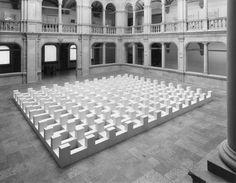 Carl Andre, The peace of Münster (1984), Westfälisches Landesmuseum für Kunst und Kulturgeschichte, Münster, Germany  Gas-beton blocks, 408-unit cellular grid, verticals and horizontals alternating, on floor, 49 x 809 x 825cm