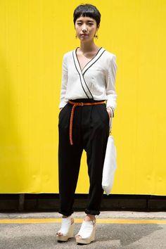 Garosu-gil, SEOUL. Jung Ji-won, student. Mango jumpsuit, Stylenanda shoes, bag from a shop at Doota fashion mall in Seoul. Photo Seongjoon Cho