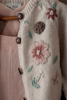Hand embroidery details on our cotton Flora Summer cardigan for girls in cream white. Such a special piece of children clothing, don't you think? - Hand embroidery details on our cotton Flora Summer cardigan for girls in cream white. Embroidery Stitches, Embroidery Patterns, Hand Embroidery, Embroidery On Clothes, Embroidered Clothes, Baby Pullover, Summer Cardigan, Baby Sweaters, Baby Knitting Patterns