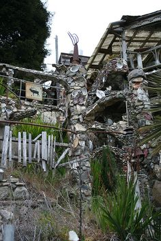 """Nit Wit Ridge,  Cambria, CA   Crazy, CRAZY """"house"""".  He decorated the exterior with everything from old tires to toilets."""