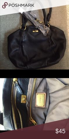J. Crew black leather brompton bag In great condition, this is a J. crew retail bag from a few years ago. It has a crossbody strap that can be attached (haven't ever used mine). It is black leather with gold hardware. Inside is in excellent condition, several compartments for organizing your stuff. Soft leather but still a somewhat structured bag. J. Crew Bags Satchels