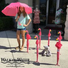 A flock of flamingos at #WalkOnWaterboutiques Love this #FlamingoUmbrella