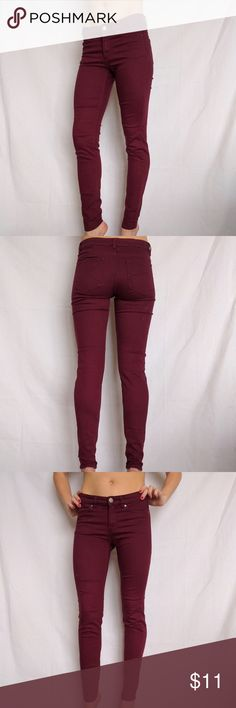 H&M Divided skinny stretch burgundy jeans 6 XS Excellent condition. H&M skinny maroon stretch jeans. 60% cotton, 37% polyester, 3% elastase. Never fit me right. Photos on model are not my own. I borrowed them to show the fit. These have been hemmed to an inseam of 26.5 inches. 4.75 across at leg opening. 13.5 across at waist. H&M size 6 but more like at XS/2 in normal brands. Divided Pants Skinny