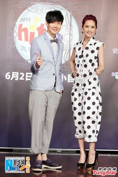 Singaporean singer JJ Lin, and Taiwanese singer Rainie Yang, attend a press conference of 2013 Hito Pop Music Awards in Taipei, March 29,  2013 (Source: Xinhua)