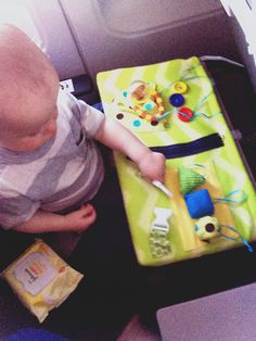 Airplane tray cover! Best thing ever!! Fun stuff on both sides keeps baby busy and toys off the floor!! Zipper, buckle, Velcro shapes, buttons, toy pocket and mirror on back with extra ribbon loops to hook on toys