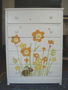Painted Chest of Drawers with a beautiful stencilled motif of flowers and a tiny rabbit hiding in the garden.  -  mekdesigns.com