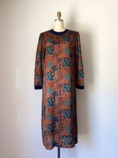 Brown & Blue Abstract animal print dress // Vintage 70s long sleeve shift dress with sheer stripes // Plus Size 14 Herman Marcus dress on Etsy, $55.00