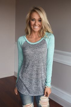A cute solid top you can dress up or down. True to size with a looser fit. Model is 5'5'' a size 0 wearing a small. **Body is a dark charcoal** Small 0-4 Medium 6-8 Large 10-12