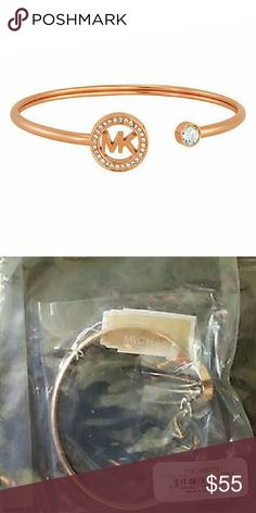 Auth Michael Kors Rose Gold Bangle BNWT Brand new with prices tags Michael Kors MKJ4652791 Rose Gold-Tone Bangle!! ITEM DESCRIPTION A Michael Kors bangle styled in rose gold-tone stainless steel. This bangle features the MK logo surrounded with a halo in crystal pave. Comes with pouch  No trades please Michael Kors Jewelry Bracelets