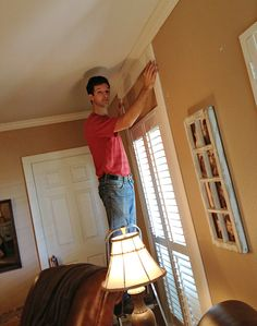 Learn how to make windows look taller by framing them with decorative molding. Click for DIY instructions.