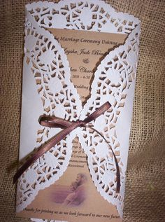 VINTAGE WEDDING PROGRAM made from dollies, hard craft paper and a ribbon.  Simply run off your program, fold the dollie and tie the bow!