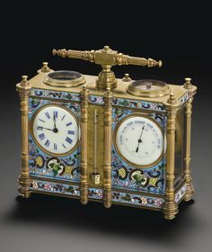 FRENCH A GILT BRASS AND ENAMEL TABLE CLOCK WITH BAROMETER, THERMOMETER AND COMPASS CIRCA 1900