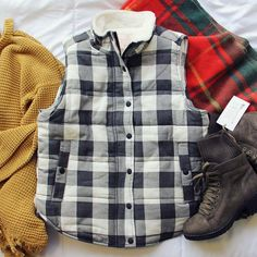 Gorgeous buffalo plaid adorns this cozy vest. Click to shop this affordable look!  www.spool72.com