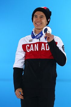 Patrick Chan wearing his silver medal on the podium at the Sochi 2014 Olympic Winter Games, held in Sochi, Russia, on February 15, 2014.