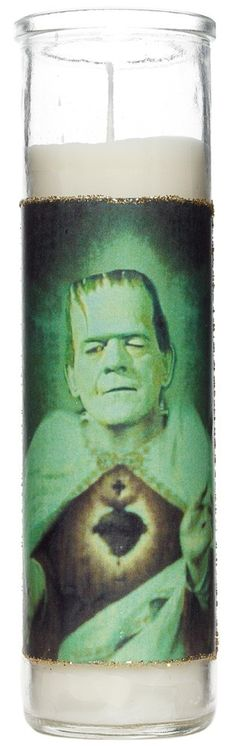 SAINT FRANKENSTEIN PRAYER CANDLE  Frankenstein's creatures has achieved Sainthood! Worship this God like manifestation with the Saint Frankenstein prayer candle! Featuring a sacred hearted monster, this white prayer candle has a glitter framed photo and is handmade by Greaser Creatures. $9.00 #frankenstein #candle #prayercandle #handmade