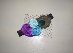 I love the colors on this headband. I don't know why, but I love the peacock-inspired pieces. Gorgeous! :)
