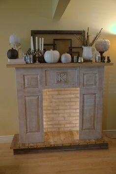 Faux fireplace. This would be so pretty with candles lit in it in place of a 'fire' Perfect for Military Housing! Take it with you when you move!
